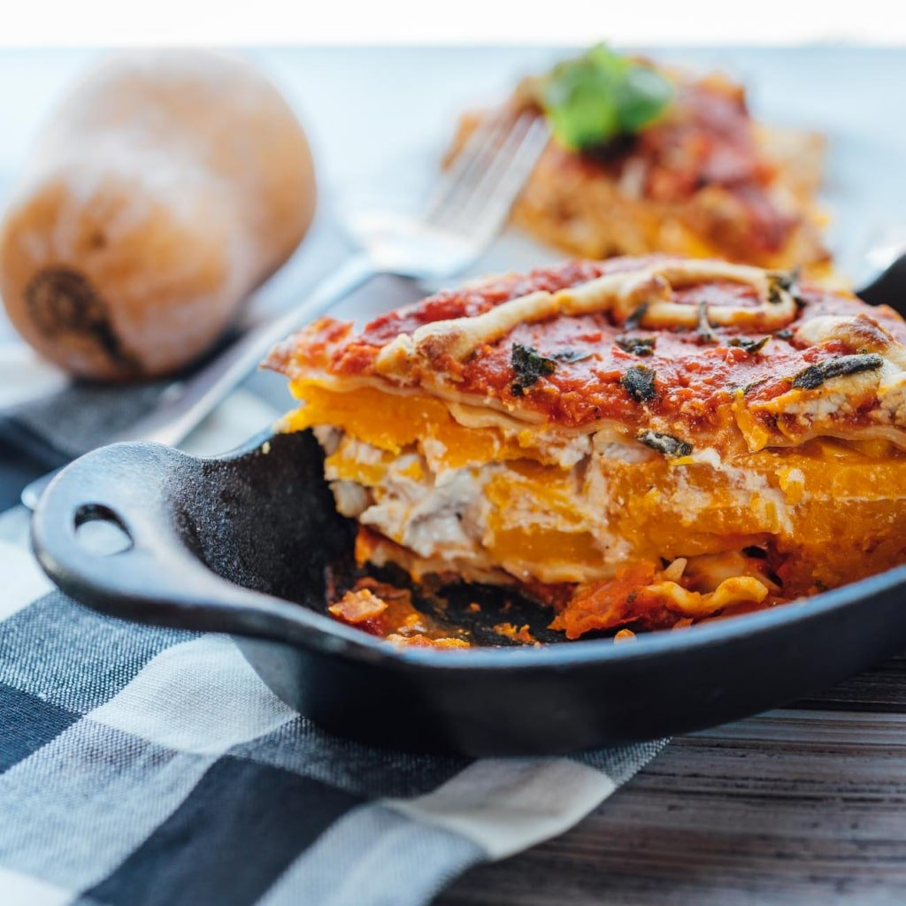 Vegan Butternut Squash and Spinach Lasagna- layered with almond ricotta and roasted butternut squash, this lasagna is sure to make for a perfect family meal!